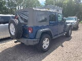 Photo 2010 Jeep Wrangler Unlimited 4WD 4dr Sport